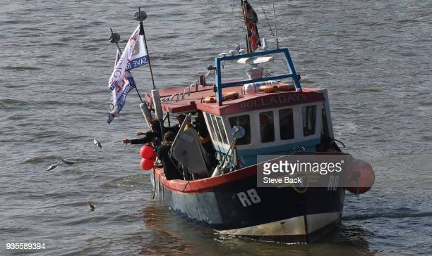 Former UKIP party leader Nigel Farage and Fishing for Leave supporters throw fish overboard into the River Thames from a fishing boat outside the...