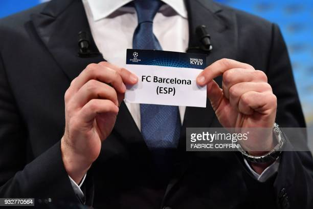 Former Ukrainian football player and ambassador for the UEFA Champion League final in Kiev Andriy Shevchenko shows the slip of FC Barcelona during...
