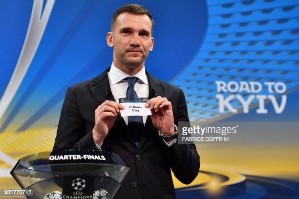 Former Ukrainian football player and ambassador for the UEFA Champion League final in Kiev Andriy Shevchenko shows the slip of AC Roma during the...