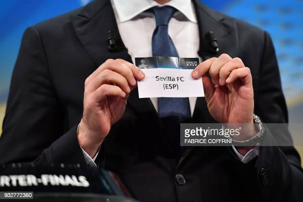 Former Ukrainian football player and ambassador for the UEFA Champion League final in Kiev Andriy Shevchenko shows the slip of Sevilla FC during the...