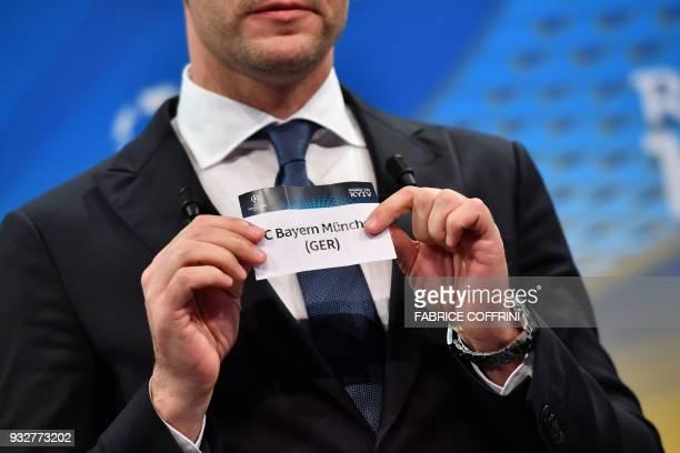 Former Ukrainian football player and ambassador for the UEFA Champion League final in Kiev Andriy Shevchenko shows the slip of FC Bayern Munchen...