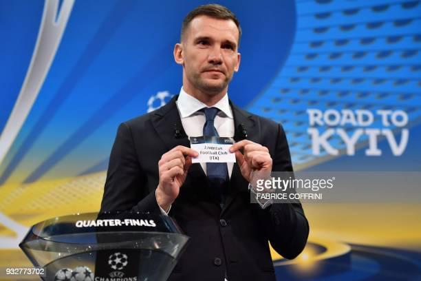 Former Ukrainian football player and ambassador for the UEFA Champion League final in Kiev Andriy Shevchenko shows the slip of Juventus Football Club...