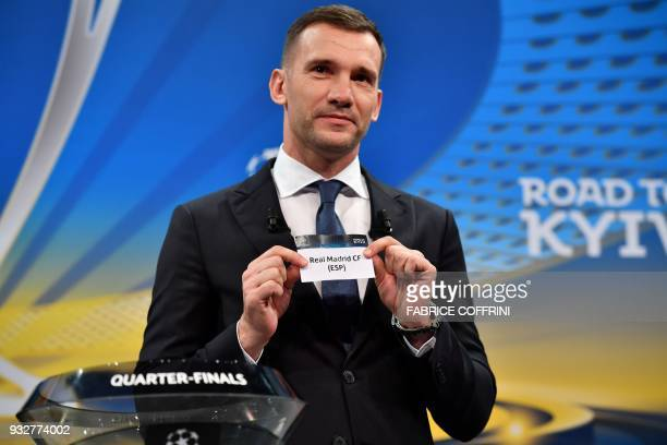 Former Ukrainian football player and ambassador for the UEFA Champion League final in Kiev Andriy Shevchenko shows the slip of Real Madrid FC during...