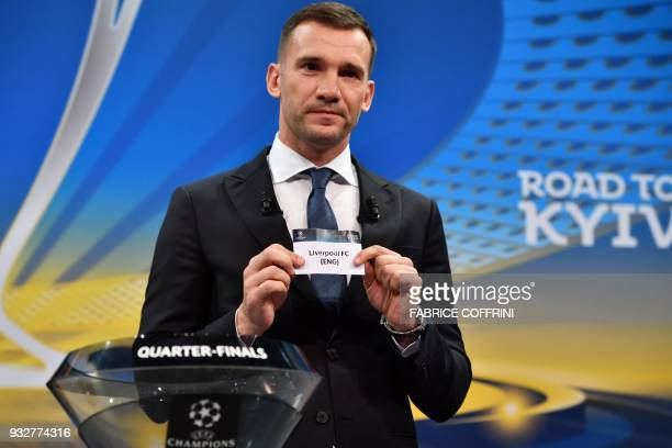 Former Ukrainian football player and ambassador for the UEFA Champion League final in Kiev Andriy Shevchenko shows the slip of Liverpool FC during...
