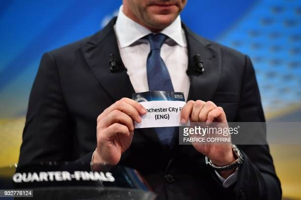 Former Ukrainian football player and ambassador for the UEFA Champion League final in Kiev Andriy Shevchenko shows the slip of Manchester City FC...