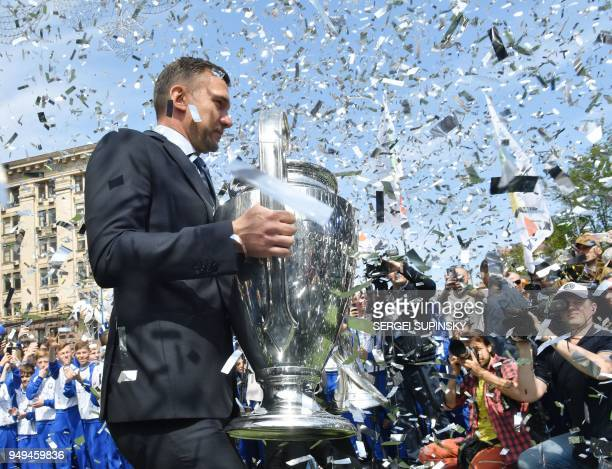 Former Ukrainian footballer and ambassador for the UEFA Champions League final in Kiev Andriy Shevchenko poses with the trophy during a ceremony at...