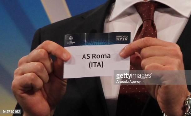 Former Ukrainian footballer Andriy Shevchenko shows the slip of AS Roma during the draw for the semifinals round of the UEFA Champions League...