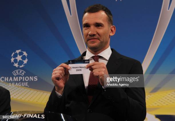 Former Ukrainian footballer Andriy Shevchenko shows the slip of FC Bayern Munchen during the draw for the semifinals round of the UEFA Champions...