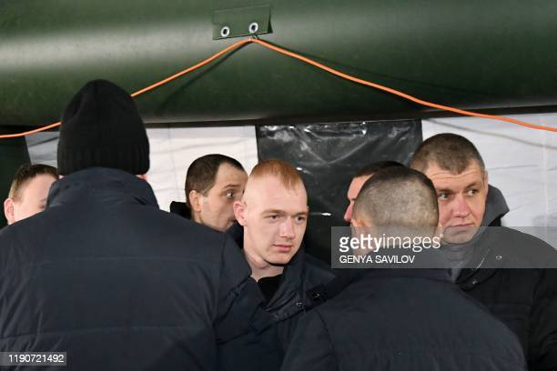Former Ukrainian prisoners are seen inside a tent following a prisoner exchange between Ukraine and proRussian rebels near the Mayorsk checkpoint on...