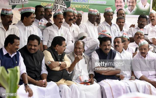 Former Union Minister AK Antony talking to senior Congress leader PC Chacko with other leaders during the farmers' march against delaying final...