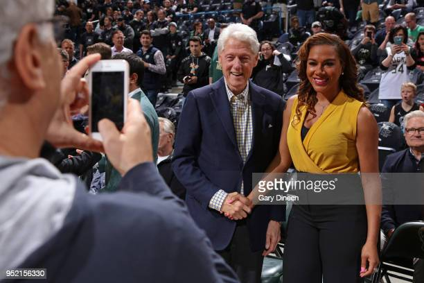 Former United State of America President Bill Clinton takes a photo announcer Roslyn GoldOnwude prior to Game Six of the Round One of the 2018 NBA...