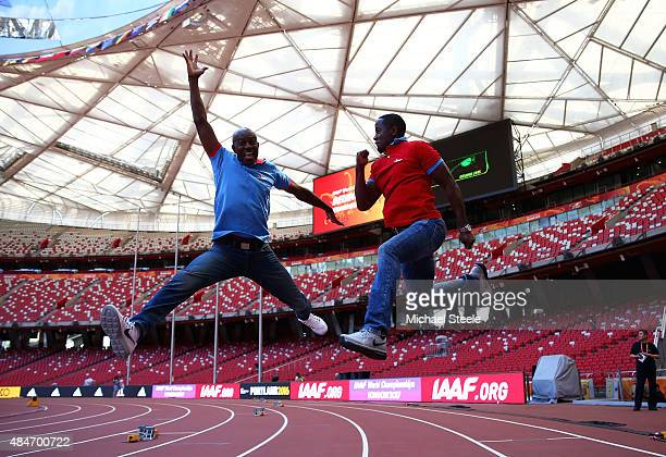 Former United States athletes Allen Johnson and Dwight Phillips jump in the air during a photo opportunity ahead of the 15th IAAF World Athletics...