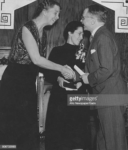 Former United States First Lady Eleanor Roosevelt and first president of the National Association for the Advancement of Colored People Walter White...