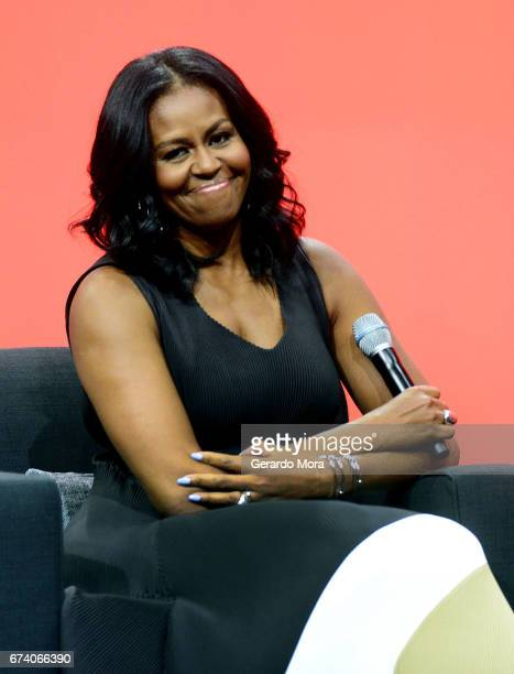 Former United States first lady Michelle Obama smiles during the AIA Conference on Architecture 2017 on April 27 2017 in Orlando Florida Michelle...