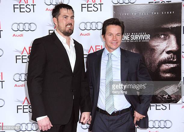 Former United States Navy SEAL Marcus Luttrell actor Mark Wahlberg attend the screening of 'Lone Survivor' at AFI FEST 2013 on November 12 2013 at...