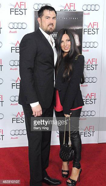 Former United States Navy SEAL Marcus Luttrell and his wife Melanie Juneau Luttrell attend the screening of 'Lone Survivor' at AFI FEST 2013 on...