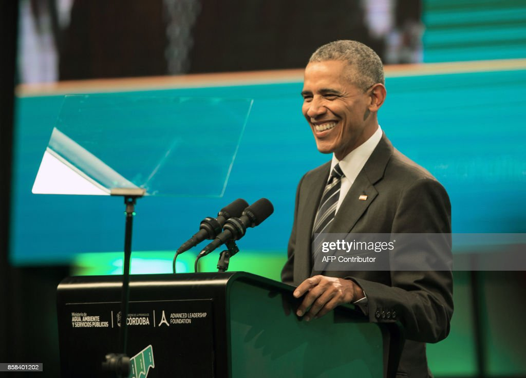 Former United States' President Barack Obama, smiles as he delivers a speech during the Green Economy Summit 2017 in Cordoba province some 740 kilometres Northwestern Buenos Aires, on October 6, 2017. The global fight for clean energy rests with businesses and ordinary people as governments lag behind, experts told an environmental conference in Argentina Friday ahead of a keynote speech by former US president Barack Obama. / AFP PHOTO / Pablo Gasparini