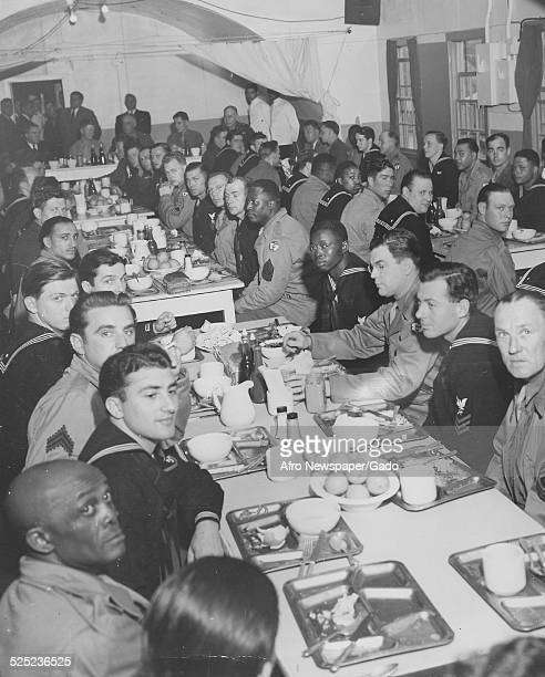 Former United States President Franklin Roosevelt American infantry soldiers and African American soldiers in a mess hall during World War 2 Adak...