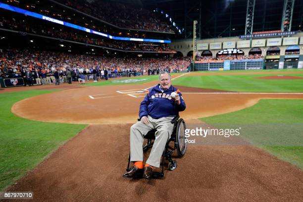 Former United States President George HW Bush looks on before game five of the 2017 World Series between the Houston Astros and the Los Angeles...