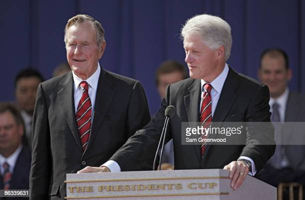 Former United States Presidents George HW Bush and Bill Clinton during the opening ceremony of The Presidents Cup at Robert Trent Jones Golf Club in...