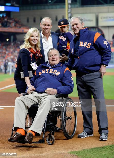 Former United States Presidents George HW Bush and George W Bush throw out the ceremonial first pitch before in game five of the 2017 World Series at...