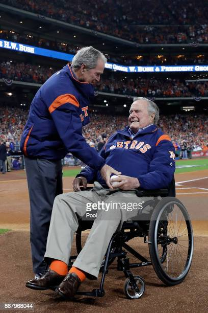 Former United States Presidents George W Bush and George HW Bush look on before game five of the 2017 World Series between the Houston Astros and the...