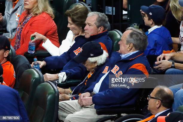 Former United States Presidents George W Bush and George HW Bush watch from the stands with former first ladies Laura Bush and Barbara Bush in game...