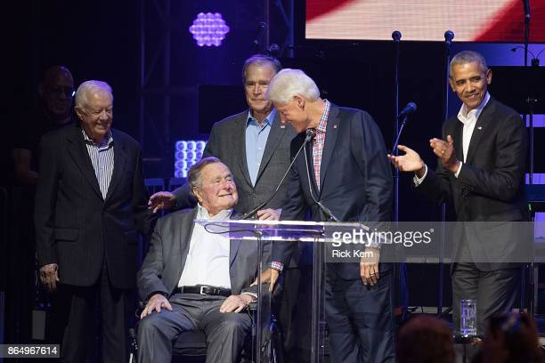 Former United States Presidents Jimmy Carter George HW Bush George W Bush Bill Clinton and Barack Obama address the audience during the 'Deep from...