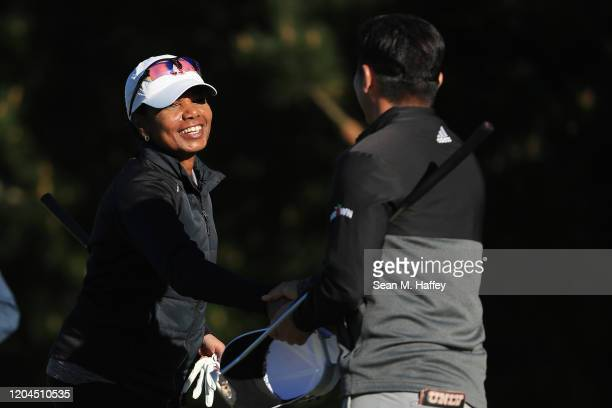 Former United States Secretary of State Condoleezza Rice shakes hands with Kurt Kitayama of the United States after completing their first round of...