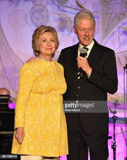 Former United States Secretary of State Hillary Clinton and President Bill Clinton speak onstage during the SeriousFun Children's Network Gala at...