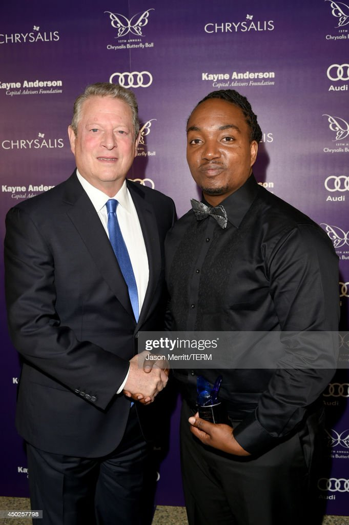 Former United States Vice President Al Gore (L) and John Dillon Award recipient Darius Coffey inside the 13th Annual Chrysalis Butterfly Ball sponsored by Audi, Kayne Anderson and Stella Artois in Los Angeles, California on June 7th, 2014.