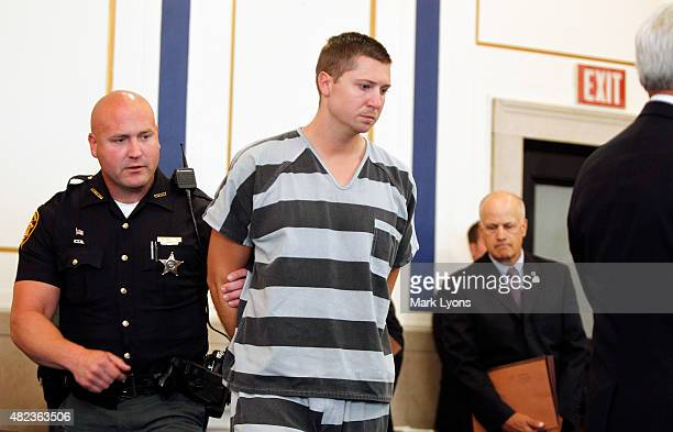 Former University of Cincinnati police officer Ray Tensing enters Hamilton County Common Pleas Court to be arraigned on murder charges July 30, 2014...