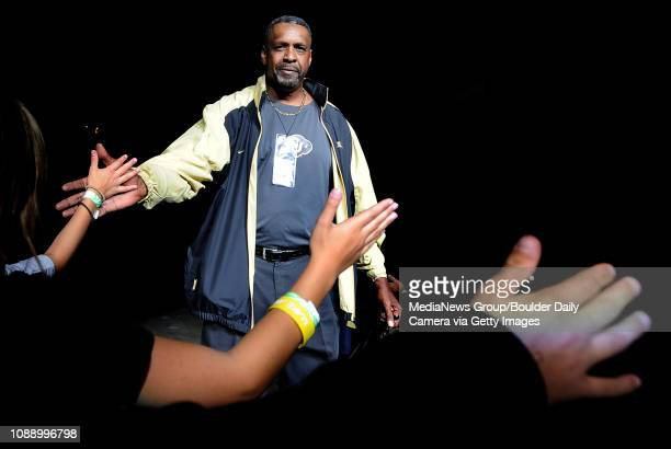 Former University of Colorado basketball star Cliff Meely highfives fans during the Parade Of Buffs on Thursday Sept 27 at the First Bank Center in...