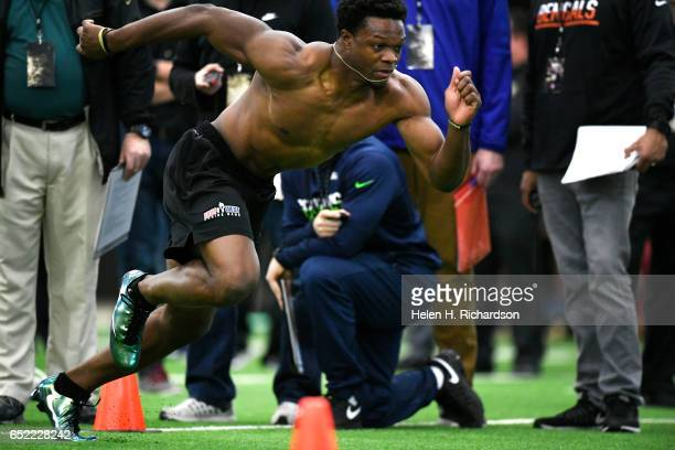 Former University of Colorado linebacker Kenneth Olugbode goes through coverage drills for NFL football scouts at the indoor practice field on the...