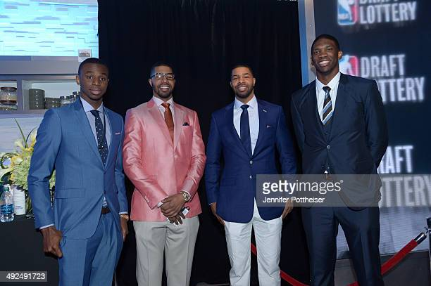 Former University of Kansas players Andrew Wiggins Markieff Morris Marcus Morris and Joel Embiid poses for a photo at a reception prior to the 2014...