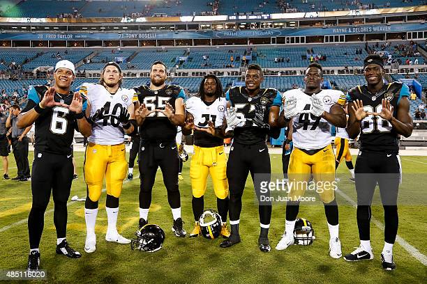 Former University of Miami Players pose for a photo after the game between Pittsburgh Steelers and the Jacksonville Jaguars at EverBank Field on...