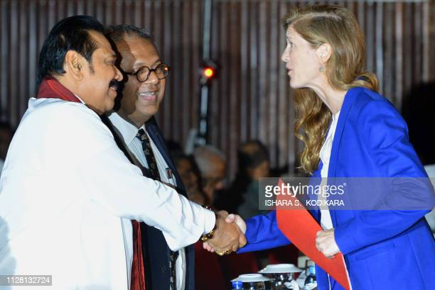 Former US ambassador to the UN Samantha Power shakes hands with former president and current opposition leader Mahinda Rajapakse and Sri Lankas...