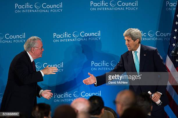 Former US Ambassador to the United Kingdom Robert Tuttle shakes hands with United States Secretary of State John Kerry after Kerry addressed the...