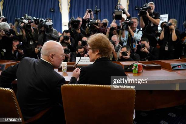 Former US Ambassador to Ukraine Marie Yovanovitch confers with her lawyer Larry Robbins while arriving before the House Intelligence Committee in the...
