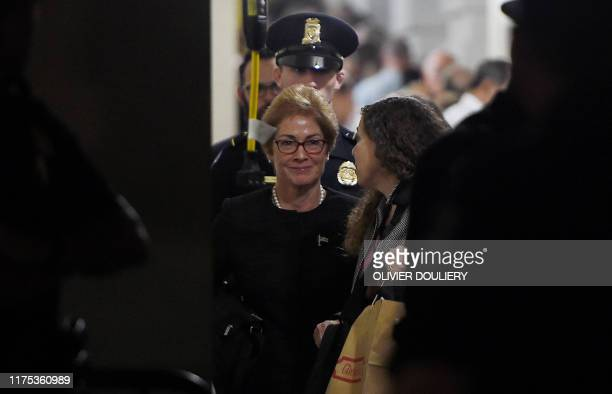 Former US Ambassador to Ukraine Marie Yovanovitch flanked by lawyers aides and Capitol police leaves the US Capitol October 11 2019 in Washington DC...