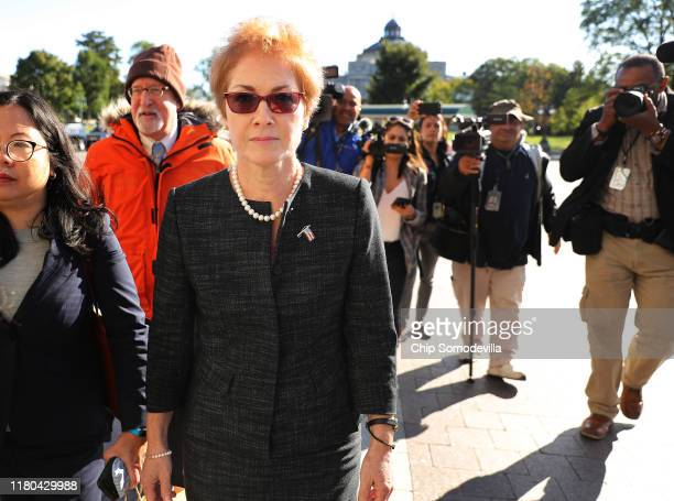 Former US Ambassador to Ukraine Marie Yovanovitch is surrounded by lawyers aides and journalists as she arrives at the US Capitol October 11 2019 in...