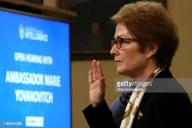 Former US Ambassador to Ukraine Marie Yovanovitch is sworn in to testify before the House Intelligence Committee in the Longworth House Office...