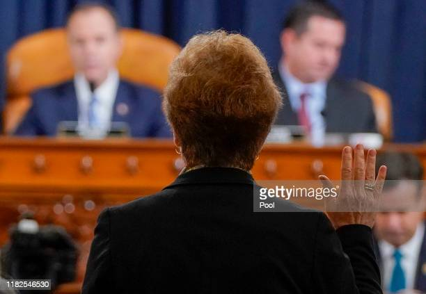 Former US Ambassador to Ukraine Marie Yovanovitch is swornin prior to testifying before the House Intelligence Committee in the Longworth House...