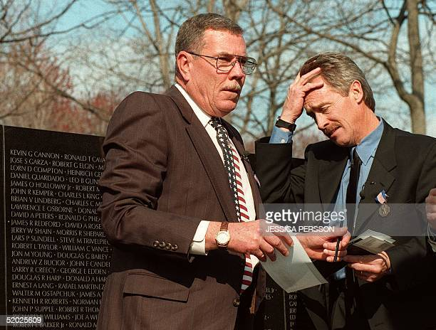 Former US Army warrant officer Hugh Thompson Jr and former Army Specialist Lawrence Colburn react 06 March after making a rubbing of fallen comrade...