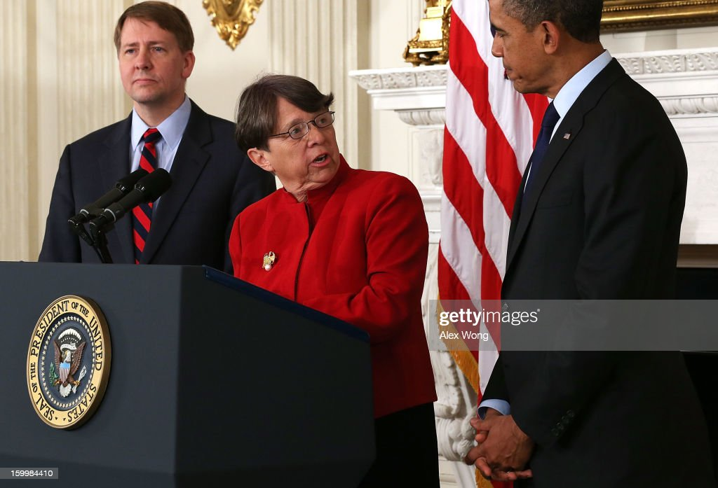 Former U.S. Attorney for the Southern District of New York Mary Jo White (C) speaks as U.S. President Barack Obama (R) and Director of the United States Consumer Financial Protection Bureau Richard Cordray (L) look on during a personnel announcement at the State Dining Room of the White House January 24, 2013 in Washington, DC. President Obama nominated Mary Jo White to become the new Chairwoman of Securities and Exchange Commission. He also re-nominated Richard Cordray for the same position Cordray has been holding.