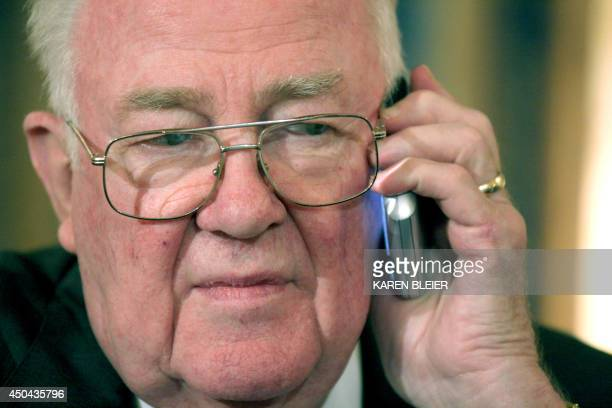 Former US Attorney General Edwin Meese III member of the National War Powers Commission listens during a phone call prior to a press conference on...