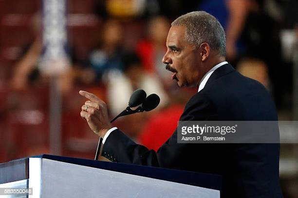 Former US Attorney General Eric Holder delivers remarks on the second day of the Democratic National Convention at the Wells Fargo Center July 26...