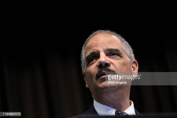 Former US Attorney General Eric Holder speaks at the National Action Network's annual convention April 3 2019 in New York City A dozen 2020...