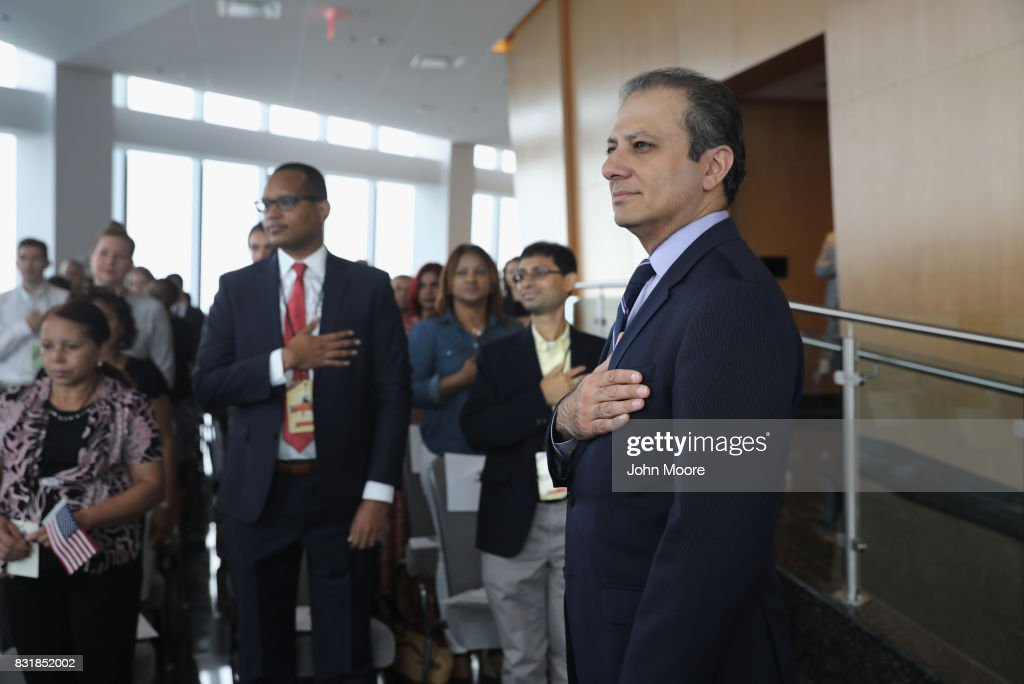 Former U.S. Attorney Preet Bharara stands for the National Anthem at a naturalization ceremony in the observatory of One World Trade Center on August 15, 2017 in New York City. Bharara gave the keynote address at the event, where 30 immigrants took the oath of citizenship to become American citizens. Bharara was the U.S. Attorney for the Southern District of New York from 2009-2017 before he was fired by President Donald Trump.