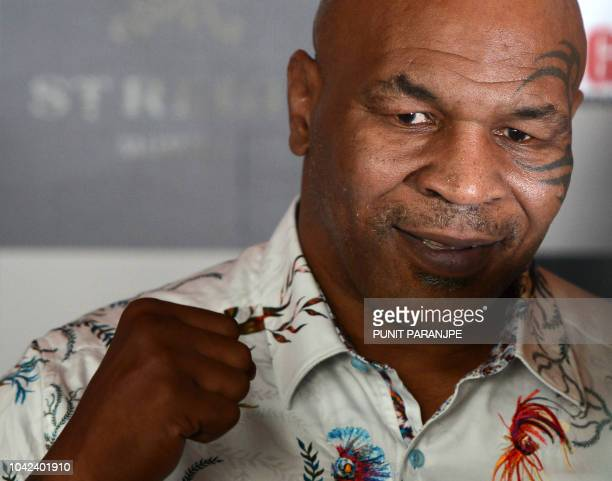 Former US boxer Mike Tyson poses during a news conference to announce India's first global mixed martial arts Kumite 1 league in Mumbai on September...